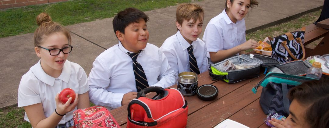 Students laughing at lunch
